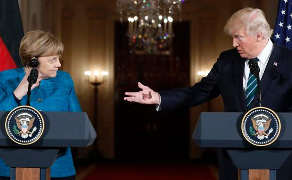 "Trump shows Merkel his ""Pay Up Sucker Tattoo!"""